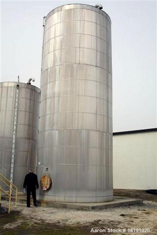 "Unused-Used Wolfe Mechanical 40,000 gallon vertical T-304L stainless steel tank. Approximately 13'-10"" diameter X 36' high s..."