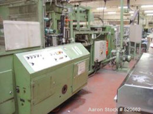 USED: Illig DRM 70/10, 1983. PP, PS pots of 50 cl. 24 cycles/m.700 x 350 mm. Mold of 10 cavities. Staking table SMK 70, 1991...