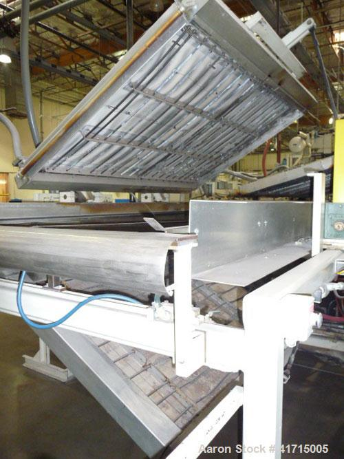 """Used- Lyle54""""Wide Web Fed Thermoformer. 244"""" Top and bottom clam shell style oven with chain feed.Includes a 160""""long pr..."""