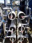 Used- Ionics Reverse Osmosis System rated for 62 gallons per minute. Complete with 6 elements, set up in 2 x 3 rows, approxi...