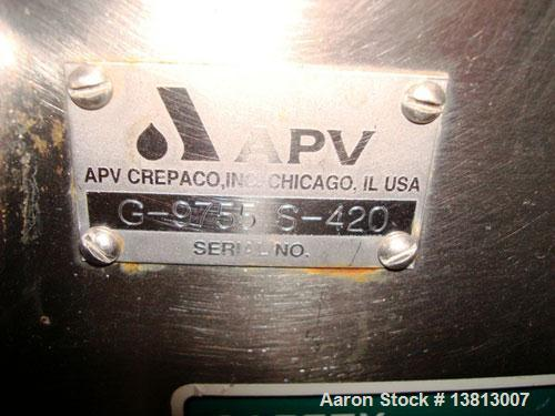Used- APV/Crepaco Fruit Feeder, Model G-9755. All stainless steel construction, on casters.