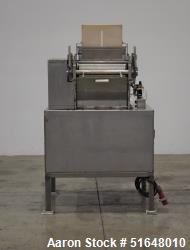 Used- Dough Extruder / Sheeter with Rotary Docking/Cutter Roller. Set up for (2) Rows. Top feed hopper, no cover. (2) Rolls,...