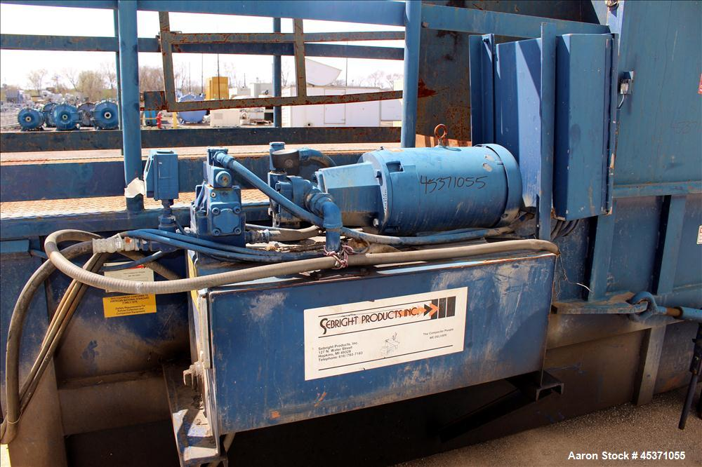 Used- Sebright Products Model 5060 Trash Compactor.