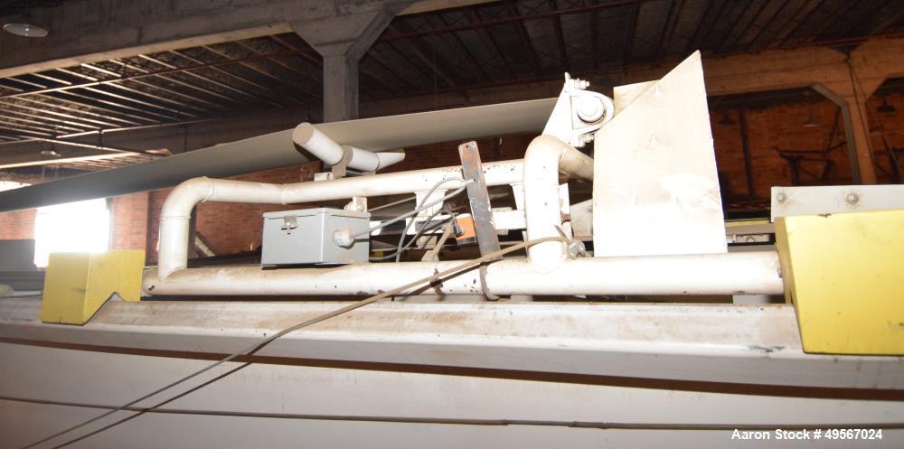 "Used- Store-Veyor Belt Accumulator, Approximate 33' Long, Carbon Steel. Bottom belt approximate 84"" wide x 30' long. Top fee..."