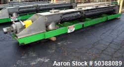 "Used- KWS Manufacturing Ribbon Style Conveyor, 304 Stainless Steel. Approximate 14"" diameter x 3"" pitch x 172"" long ribbon s..."