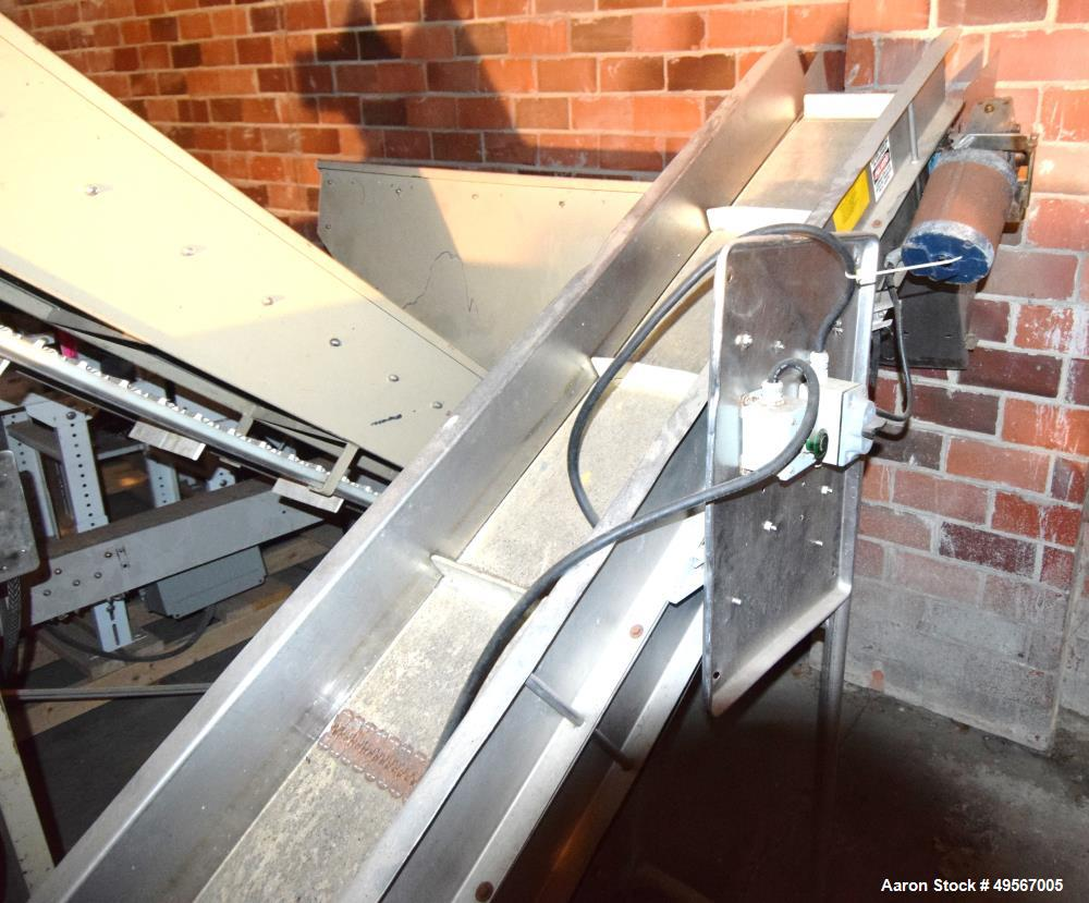 """Used- Inclined Rubber Belt Conveyor. Approximate 12"""" wide x 108"""" long pleated belt with 24"""" long x 2"""" tall pockets. 48"""" Long..."""