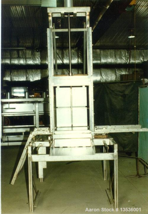 "Used-Millerbernd 640 Block Cheese Cutter, vertical and horizontal cuts. The part that pushes the block through is 22"" wide x..."