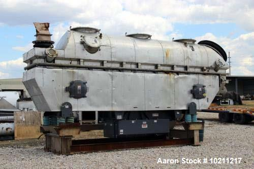 "Used- Carrier Stainless Fluid-Flow Vibrating Fluid Bed Dryer Cooler; Model QAD-6060S. 46"" wide x 22' long inside dimensions...."