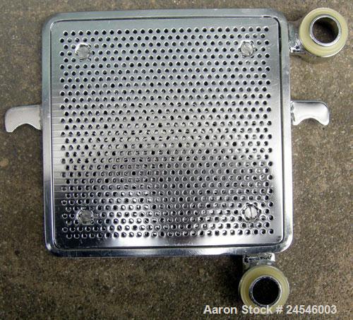 "Used- Seitz Enzinger Noll Pilot Polishing Press, Type 20/17. (18) 7"" x 7"" 316 stainless steel plates, approximately 1/2"" thi..."