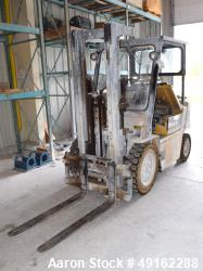 "Used- Caterpillar 5000 Pound Propane Forklift, Model V50E. Solid tires, double mast, approximate 48"" long forks. Serial# 4EG..."
