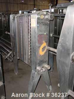 """Used- APV Plate Heat Exchanger, Model HX, Stainless Steel. Approximately 70 square feet. (54) 9"""" wide x 34"""" long plates. 24-..."""