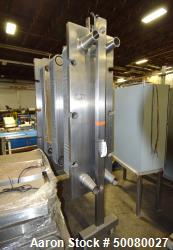 "AGC Plate Heat Exchanger. Approximate (62) 15"" wide x 48"" tall stainless steel plates. Mounted on a..."