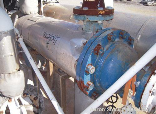 Used- CMS Shell and Tube Heat Exchanger,  57 square feet, horizontal. Carbon steel shell rated 150 psi at 400 deg F, (73) 3/...