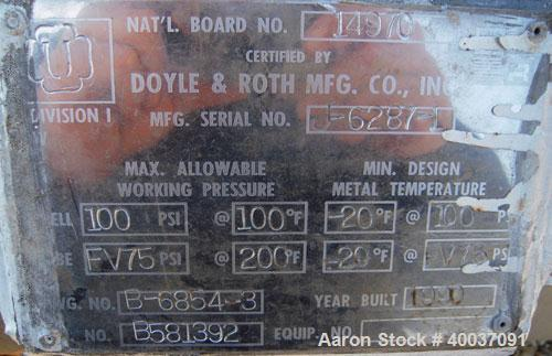 Used- Doyle and Roth Shell and Tube Heat Exchanger, 98 square feet, vertical. Carbon steel shell rated 100 psi at 100 deg F,...
