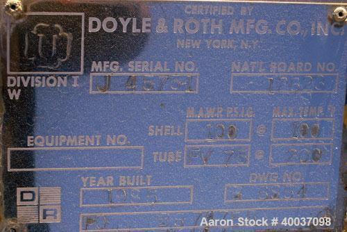 Used- Doyle And Roth Shell And Tube Heat Exchanger, 98 square feet, vertical. Carbon steel shell rated 100 psi at 100 deg.f....