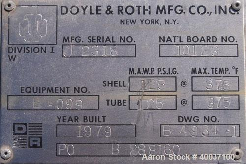 Used- Doyle And Roth Shell And Tube Heat Exchanger, 31 square feet, vertical. Carbon steel shell rated 125 psi at 375 deg.f....