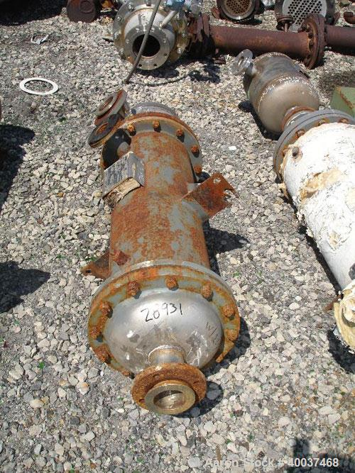 Used- Doyle and Roth Shell and Tube Heat Exchanger, 99 square feet, vertical. Carbon steel shell rated 100 psi at 100 deg F,...