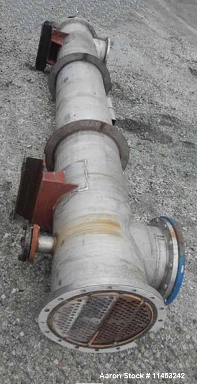 "Used- Perry Products Shell & Tube Heat Exchanger, 497 Square Foot, Stainless Steel. (210) 3/4"" diameter x 144"" long tubes ra..."