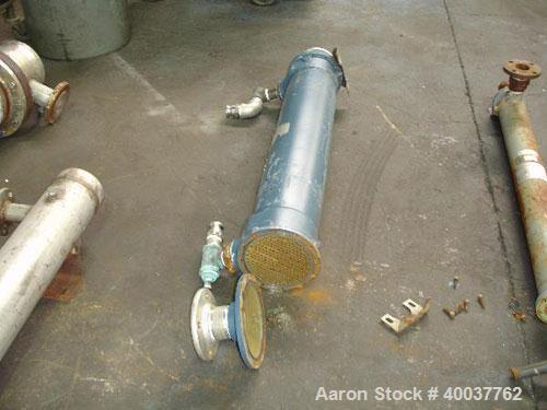 Used- ITT Shell and Tube Heat Exchanger, 82 Sq. Ft. , 316 stainless steel tubes, tube sheets, bonnets and shell with (210) 3...
