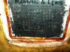 Used- Manning And Lewis Shell And Tube Heat Exchanger, 557 square feet, vertical. Carbon steel shell rated 100 psi at 150 de...
