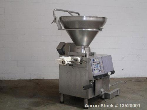 Reconditioned Handtmann VF200 Vacuum Stuffer with linker.  Has digital portion control, approximately 500 lb hoppr, 16 rotar...