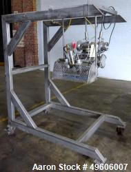 Used- 3 Up Water Wheel. Mounted on Portable Stainless Steel Cart.