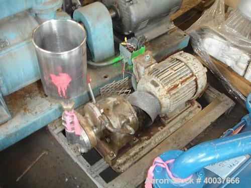 """Used- Gaulin Colloid Mill,Type 4D, stainless steel.Top feed hopper. 1 1/2"""" inlet, 1"""" outlet. Direct coupled to a7 1/2hp,..."""