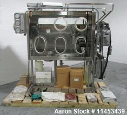 Used-Used Quadro Comil mounted in isolator, model U10, stainless steel construction, missing beater and screen, direct coupl...