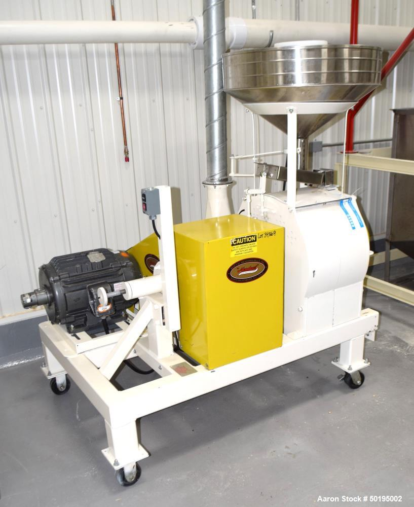 Used-Meadows Mills Stone Burr Mill, Model 20N, Carbon Steel. Includes a feed hopper. Driven by a 10hp motor. Set up with blo...