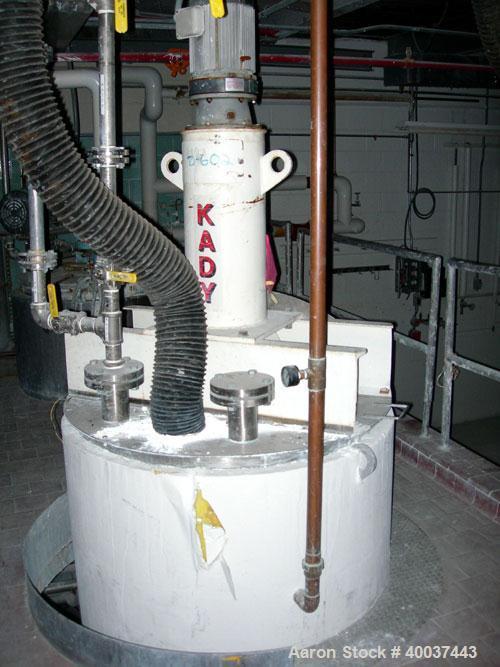 "Used- Kady Mill, Model 5C, 304 Stainless Steel. Approximately 300 gallon capacity. 42"" diameter x 68"" deep tank. 8"" diameter..."