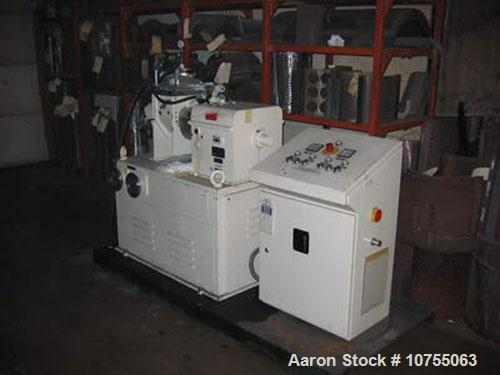 """Used- AMK mixer extruder model VIV-4, 2.5"""" discharge screw, 208 volt operation at 60 hz, sigma jacketed stainless steel tang..."""