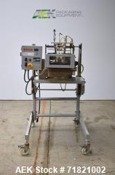 Bosch Doboy Semi-Automatic Bag Top Labeler, Model JSL.  Heat seals a paper header label to the top o...
