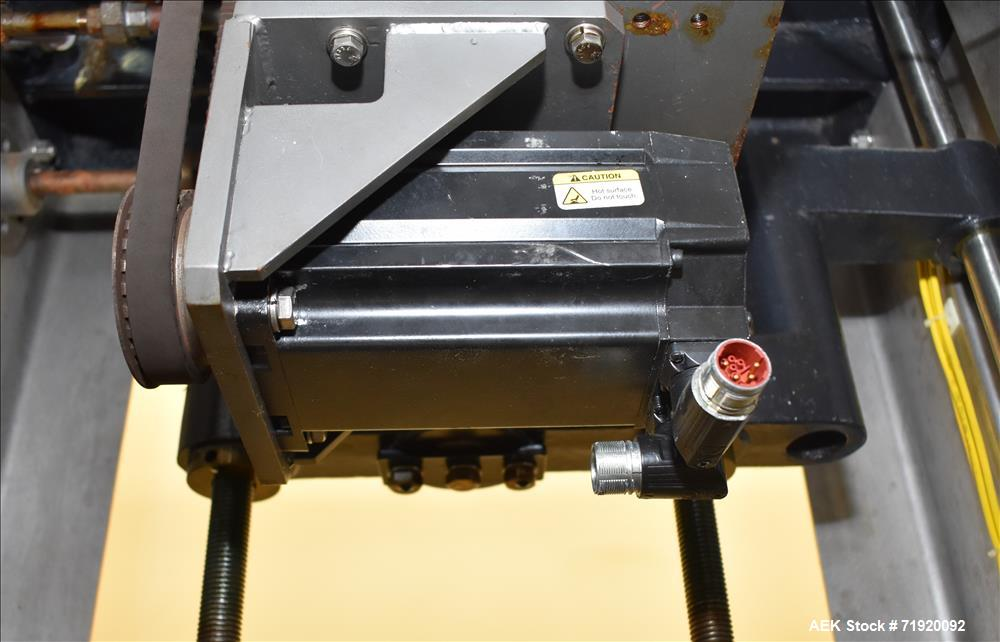 "Used- Change Parts Inc 8-Head Press on ""Snap"" Capper, Model SC-8-15."