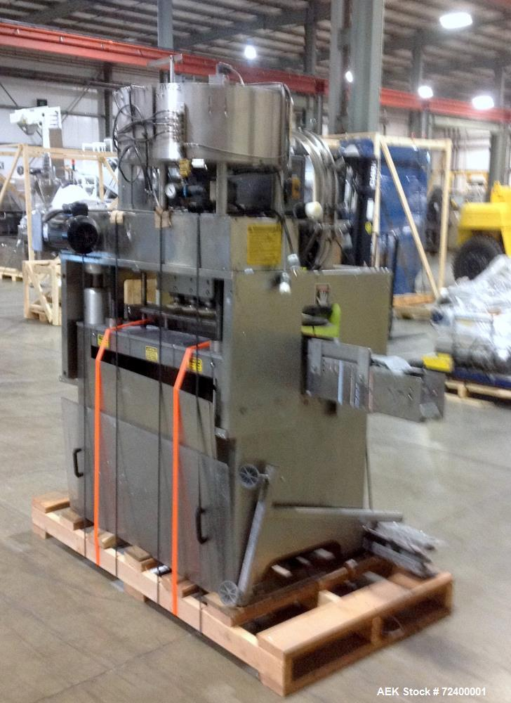 Used-Kaps-All Model C8 Automatic Inline Screw Capper. Has 4 sets of spindles (8 quills) and is capable of speeds from 40 to ...