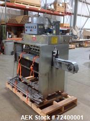Kaps-All Model C8 Automatic Inline Screw Capper. Has 4 sets of spindles (8 quills) and is capable of...