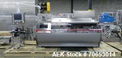 https://www.aaronequipment.com/Images/ItemImages/Packaging-Equipment/Cartoners-Horizontal-Load-Automatic-Load/medium/Bosch-CUC-2003_70653014_a.jpg