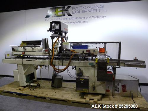 """Used- Bivans Vertuck Semi Automatic Vertical Cartoner, Model 74G. Capable of speeds up to 120 CPM. Has 6"""" centers for a cart..."""