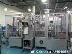 Used-Cariba Model C230 Automatic intermittant motion vertical cartoner with robotic loader for bottles/jars. Capable of spee...