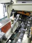 Used- Bivans Vertuck Semi Automatic Vertical Cartoner, Model 74G. Capable of speeds up to 120 CPM. Has 6