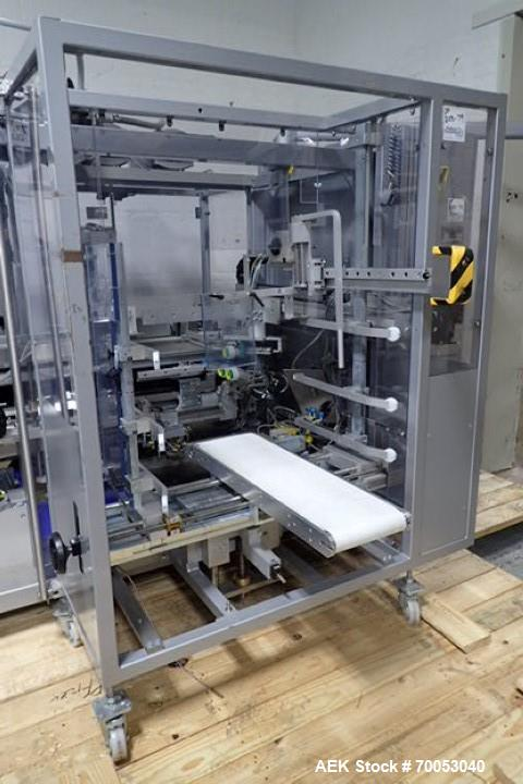 Used-Used Skinetta top loading case erector packer, model CP 150, servo driven loading head, with powered case feeder and ca...