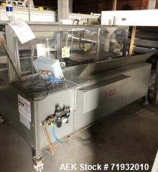 Used- Combi Model 2EZ Case Erector Sealer.