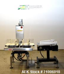 Used-Ishida Checkweigher, Model DACS-W-030-SB/PB-I, 3.0 Kg  Maximum Capacity.  Serial # 41301, built 1999.  Offered as-is, a...