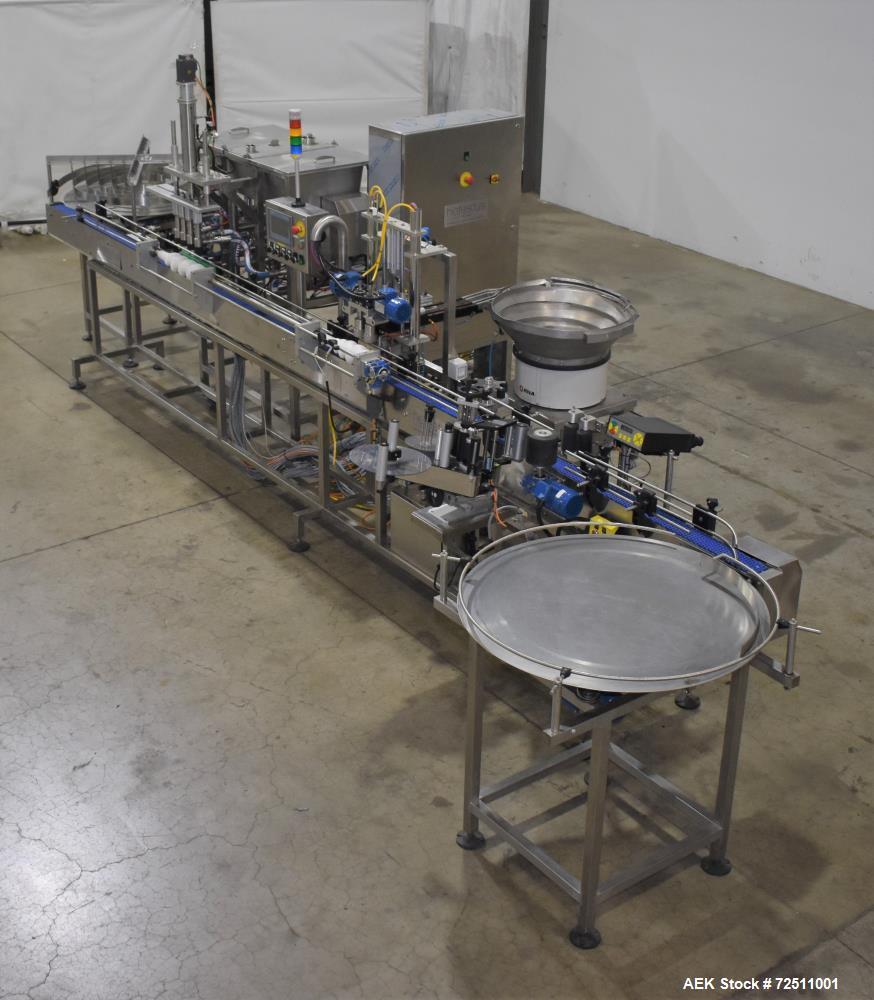Used- Hefestus Bottling Line. 20-30 bottles per minute. Includes the following: New England Bulk Bottle Unscrambler, Rotatin...