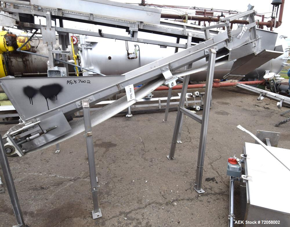 "Used- Incline Belt Conveyor. Rubber belt approximate 12"" wide x 96"" long with a pulley drive motor. Bottom feed hopper, appr..."