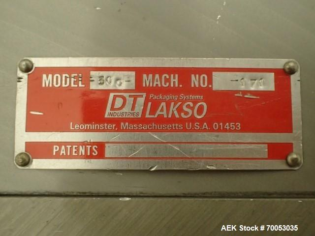 Used-Used Lakso twin head cotton inserter, model 300, speeds up to 300 bottles/minute, with timing screw and integrated slat...