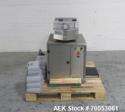 Used Capsugel Xcelodose 120 capsule filler with controller and associated tooling.  Unit is CE rated...