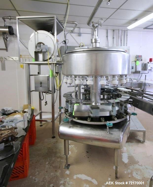 Used-Federal 18-Valve Rotary Filler, with 5-Station Rotary Capper, with Stand Alone Capping Feed System, Mounted on Stainles...