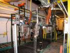 Used-Toledo scale two line drum filling line with individual automatic load cell controlled filling nozzles, drum feed is au...