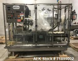 Used-Filler Specialties Monoblock Filling System. Has 24-head filler, pin-style cap sorter and 8-head capper. Wormscrew to s...