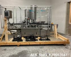 Used Groninger inserter capper, Model KVK 206, speeds up to 10000 BPH(166 BPM), with (2) 6 head stat...